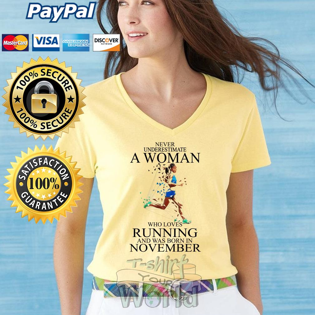 Never Underestimate A Woman who loves Running and was born in November V-neck T-shirt